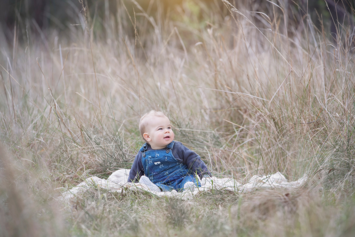 Baby photography outside in a field of grass